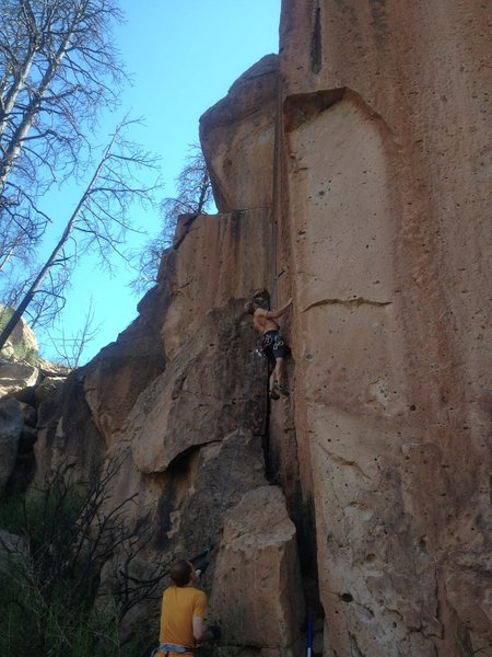 """Climbing the Black Streak, To the right is the 5.11 arete """"Hanging The Dog"""""""