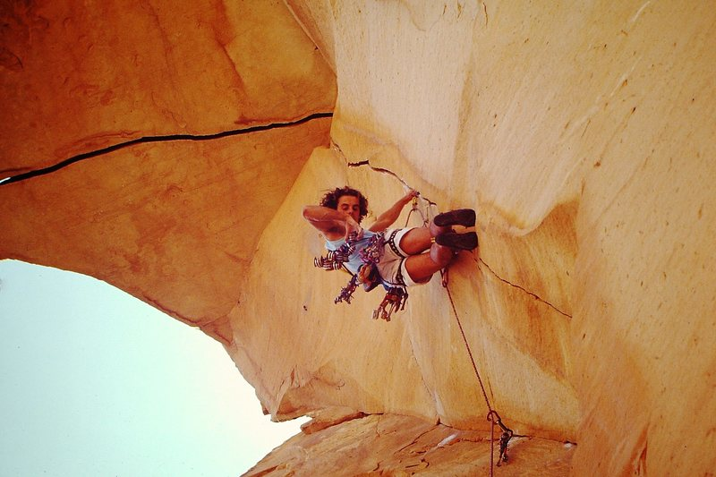 Desert Gold (5.13) Red Rocks. We were told we made the first on-sight & ground up ascent by a local climber, maybe it was (1989). Great route in a magical area.