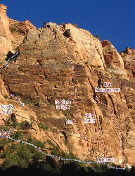 Riddler's Delight climbs the green-lichened face above the Zion Lodge