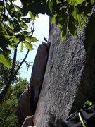 James rappelling just above the boulder start of Knuckle Duster