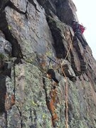 Just about to enter the crux on the final pitch.