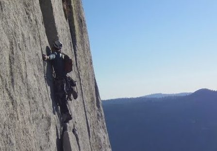 climbing on the face of half dome