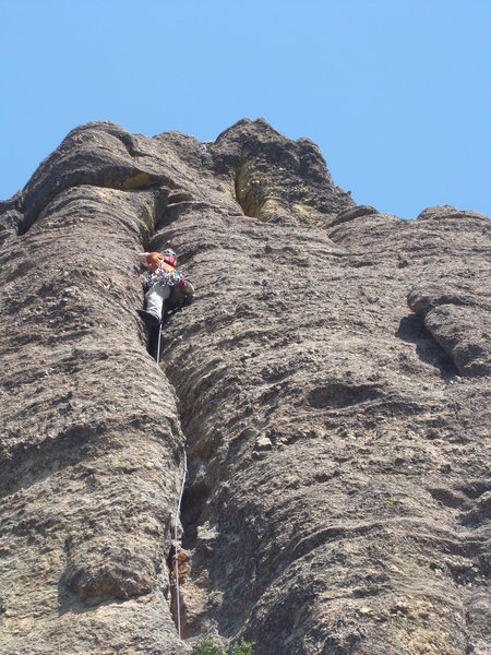 Nearing the summit with a sick hand crack on Empire State Building. Custer State Park. Black Hills, South Dakota.