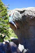 Rock Climbing Photo: Pulling on slopers before the last reach.