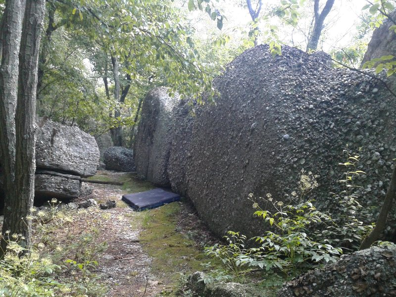 Lowgistics spans the three boulders with the pad in front.