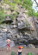 Rock Climbing Photo: Bolts marked in red. Simon reaching anchor up ther...