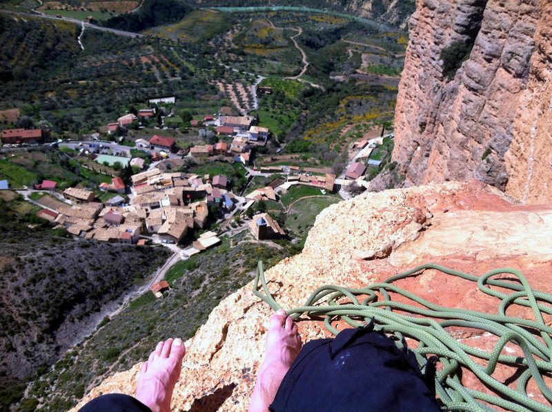 """Taking a rest on """"the throne.""""  A large limestone block hundreds of feet off the ground on """"Mosquitos."""""""