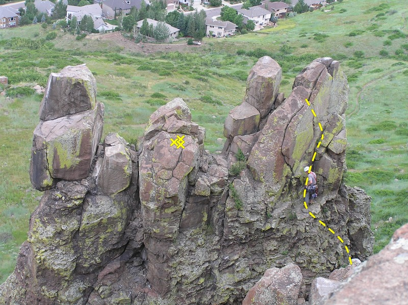 Getting the first good gear placement in just above the poor rock. This shows the majority of the route.