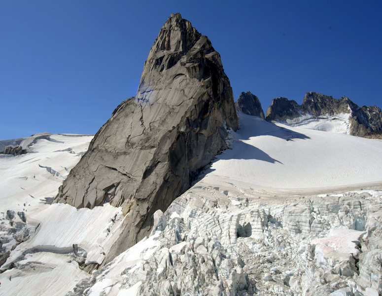 East face of Pigeon Spire and the Howser Towers in the background.
