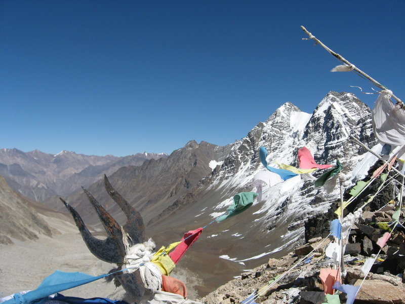 rest day trek to 17000ft pass.  Hindu trishula and Buddhist prayer flags.  Tibet is on the horizon.