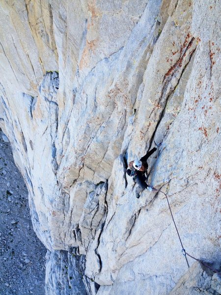 Amy Ness scoping out the first 5.11a crux on P3.