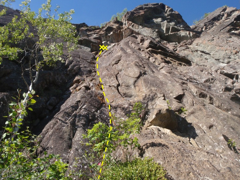 Climb the dirty dihedral, there is a bolt on the next route right 12' up on the arete.