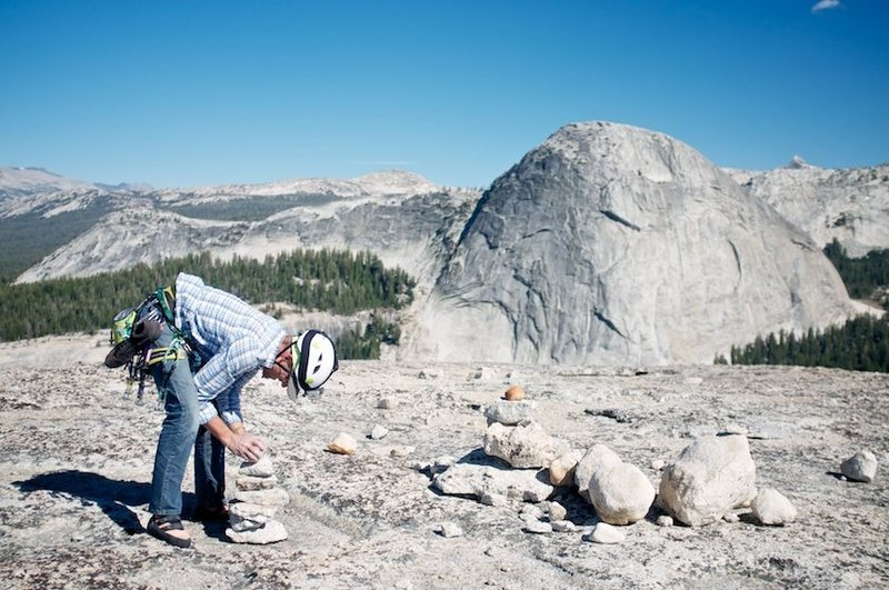 Greg adds to the cairn collection on the summit of Daff, with Fairview in the background.
