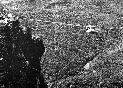 The tyrolean traverse that OB used to do. The last team to do it, led by Mike F., was in 1972 when the large anchor boulder on top of the Camel became unstable. Photo credit: Dan Madden. Photo courtesy of Mike Fischesser.
