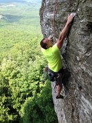 Rock Climbing Photo: Dennis Buice topping out the headwall.