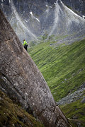 Tracy Borland on the delightfully slabby crack moves of King Ex at the Falcon Slab in Hatcher Pass, Alaska.