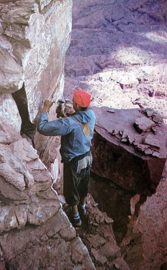 Layton Kor drilling a bolt on the FA of Castleton Tower, Castle Valley<br> <br> Photo by Huntley Ingalls