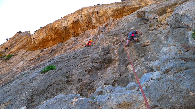 The climber on the right is following Oreads. The climber on the left is leading Mustass.