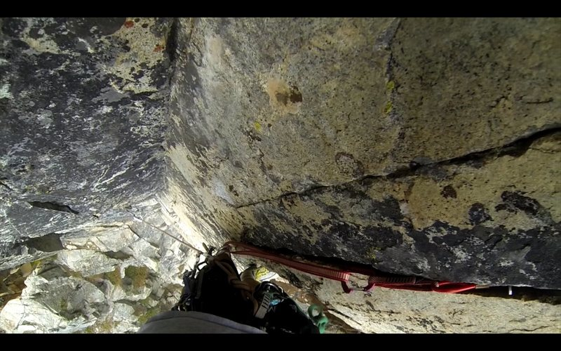 route on the north side of Overflow Dome.  sandbagged at 5.10+.  gear to two bolts.  looking down from the rest before the crux sequence.