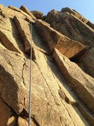 Rock Climbing Photo: Feathers iss the left dihedral (just left of rope)...