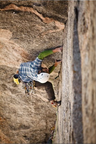 Rock Climbing Photo: On the crux of pitch 2 during the FFA.  Photo by J...