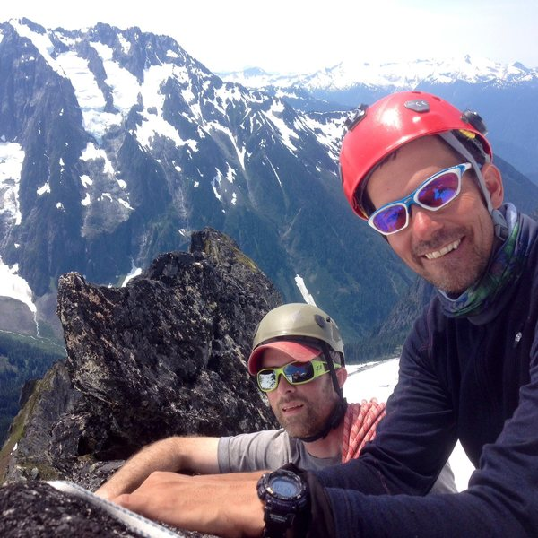 Three can barely fit on the tiny summit of the Aiguille de l'M, Boston Basin, North Cascades National Park