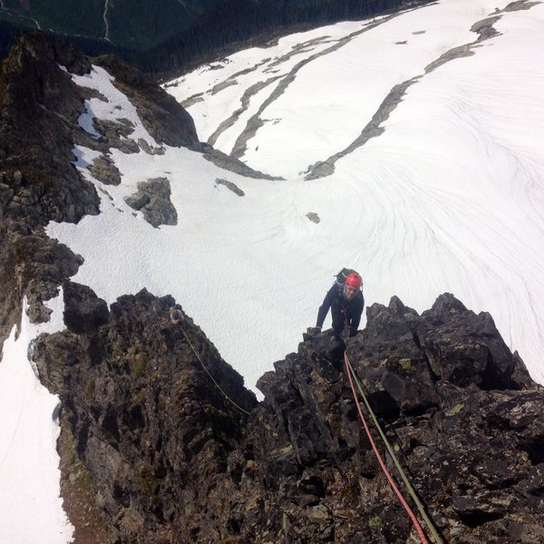 Brandon and Brown on the airy pitch 4 of the South Ridge, Aiguille de l'M, Boston Basin, North Cascades National Park.