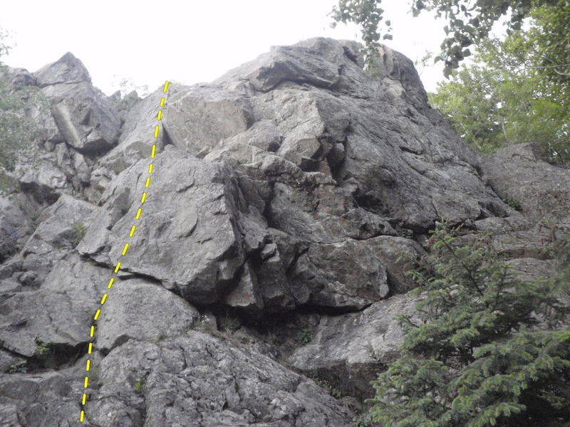 Thinline climbs the lower angled face to the left of the overhanging routes.