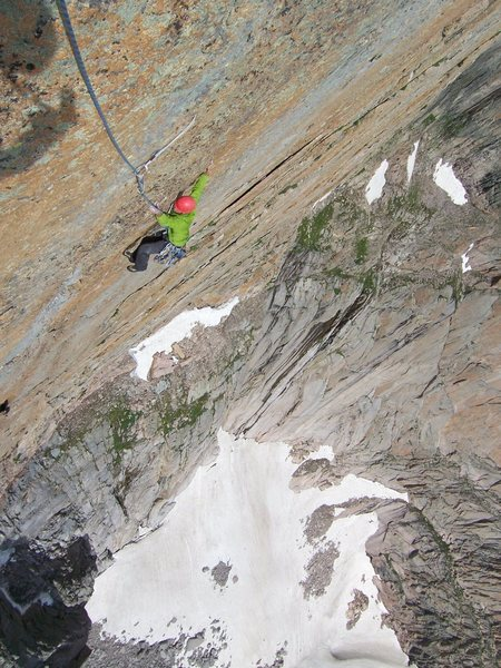 Aaron following the crux traverse on P2....