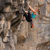 Chrissy pulling the crux roof<br> Standing on the Edge of Extinction (5.11)