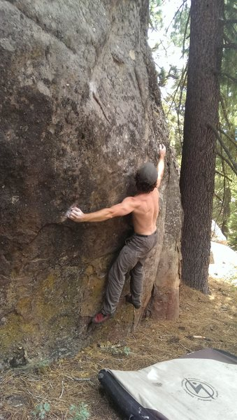 Rock Climbing Photo: Bumping the right hand on Softly, Softly.