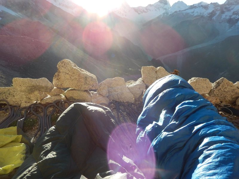 Waking up to the sunrise on the bivy ledge of the original route. Best moment of the trip!