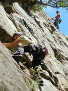 Rock Climbing Photo: Ryoko finding feet before the mini-roof undercling...