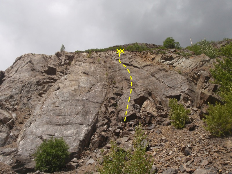 Progression climbs directly under the anchor on the upper cliff.