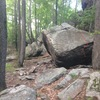 Spiderman cave is the line right of the low apex of the boulder.