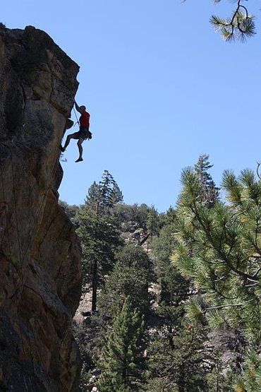 Jason clipping the anchors on Out of Sight (5.10b), 8000 Foot Crag