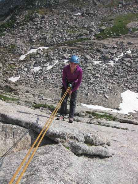 Last of four single rope raps.  Finishes on grassy ledge.