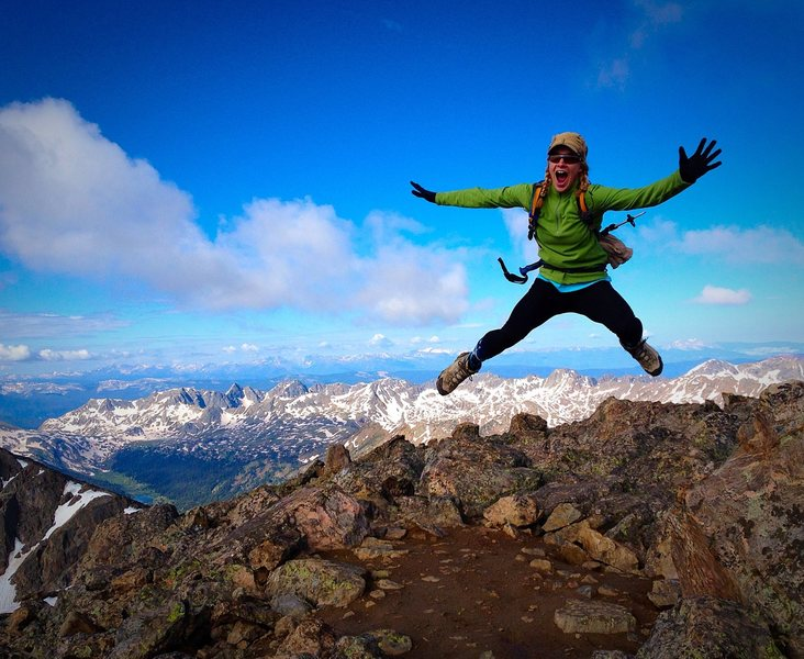 Beka Fritz celebrating on Mount of The Holy Cross summit