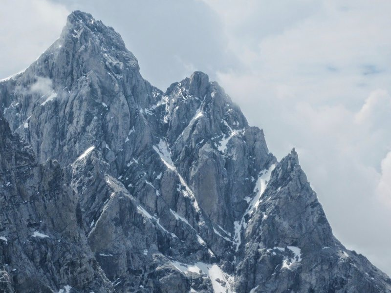 """The left arm of the """"V"""" in the photo is the Black Ice Couloir; the right is the Enclosure Ice Couloir.<br> <br> Teton Ranger Blog, July 12, 2014<br> http://tetonclimbingenclosure.blogspot.ca/p/enclosure-couloir-2013.html"""