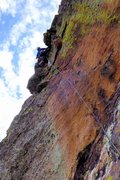 Rock Climbing Photo: Topping out on the 5.10b section of pitch 3, Aug. ...
