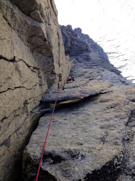Peter Pribik following the crux P4 fists & OW  dihedral with the giant death block looming in the foreground