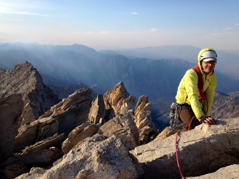 Peter Pribik on the summit of Matterhorn Peak, with the endless ridge of the Dragtooth seen in the background. This linkup makes for a long day!
