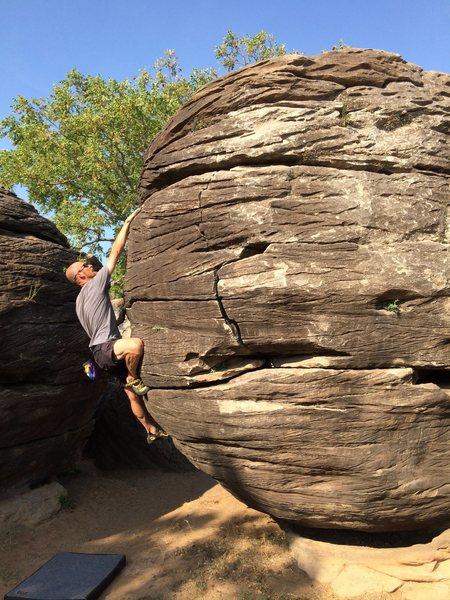 """Kansas bouldering?""  Ray Weber boulders at Rock City near I-70 in Kansas."