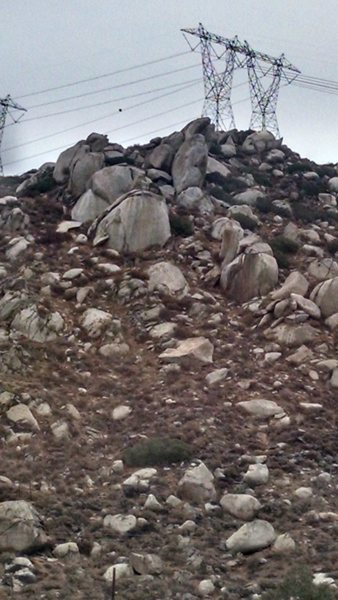 The High voltage hill behind the church featuring the Lizard King Boulders