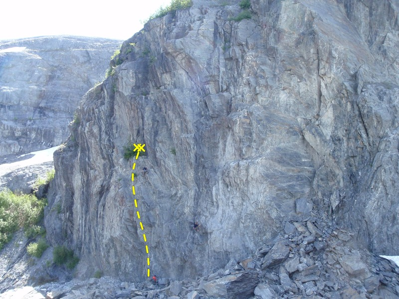 Tibetan Prayer Flags Made In China climbs to the brushy ledge half way up the wall.