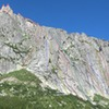 Overview of Spazzacaldeira, with the famous La Fiamma and Il Dente on the ridge. <br> <br> 1. Fiamma Via Sud 6a+ 8p<br> 2. Seifert 6b+ 3p<br> 3. Nebel des Grauens 7a (6b+ A0) 3p<br> 4. Via Leni 6a 5p<br> 5. Va Col Vento 6c+ 4p<br> 6. Tiramisu 6b 4p<br> 7. Piache Inferiori 7a (6b A0) 2p<br> 8. La Stria 6b<br> 9. Lasciamili 6a 7p<br> 10. Buttamigiu 6b 5p<br> 11. La Sirena 7a+ (A0) 5p<br> 12. Militärgratli (SE-ridge) 4a<br> 13. La Fiamma 5c+<br> 14. Il Dente Normalweg 6b<br> 15. NE-ridge 4c<br> 16. Giovanne d'Italia 7b<br> 17. Dente per Dente 6a<br> 18. Via Felici 6a<br> 19. Coco Driller 7a<br> 20. Gioca il Jolli 7a+<br> 21. Kind of Magic 7a<br> 22. Nasi Goreng 6a<br> 23. Golden Pillar 7a<br> 24. Teorie del Cele 6b+<br> 25. La Dama 7a<br> 26. Benno 6b<br> 27. Peperina 6a+<br> 28. Andamento Lento 5c<br> 29. Excalibur 6c<br> 30. La Colazione 7a+<br> 31. Daccapo 7a<br> 32. Steinfresser 6a+<br> 33. Gi-Emme 7a<br> 34. Nuova Via per Claudia 6a+/6b<br>