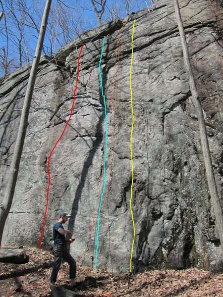 From the Facebook group: Powerlinez -  Beta Shed<br> <br> RED: Flake n' Take. Climb the right facing flake to a blank section, 10ish moves get you up to the overlaps/under clings above to a finish left of the sapling.<br> <br> TURQUOISE: Chopper Noise, 5.9. Use the left facing large flake system, some hard moves through the top third to gain the upper horizontals.<br> <br> YELLOW: Paper Mache. 10ish face climbing, the large flake to the left is off-limits.