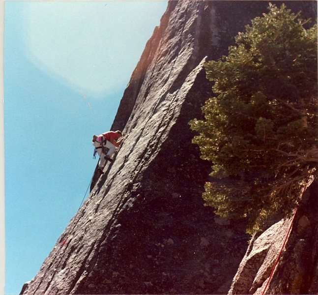 "Leading to the crux on ""Etude"" after the two 5.10 sections on the slab. June, 1987."