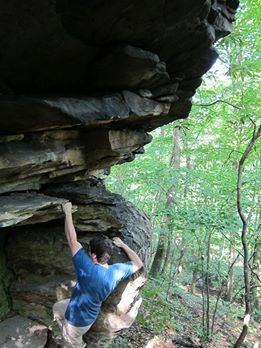 Shot of part of 3-D, you sit start just below where my buddy is at, then work to the left onto the over hang. He is a newb climber and could not do first move from sit start or top out the climb but it is pretty easy, with that being said I say V1