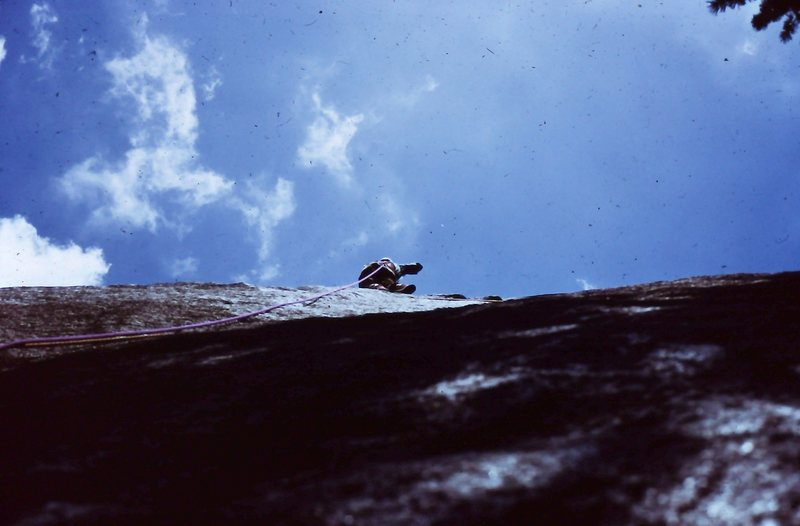 "Peter Hayes on lead, hand drilling the third bolt on ""Hades"", 1973."